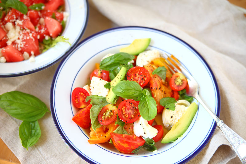 Healthy Eating Freshness Food Food And Drink Ready-to-eat Plate Basil Herb Close-up Indoors  No People Salad Caprese Burrata Cheese Overhead Natural Light Watermelon Colorful Homemade Food Fork Fabric Napkin Refreshing Summer Food
