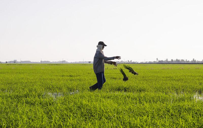 Man standing on grassy field