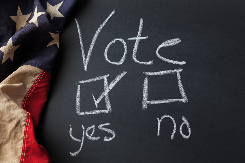 Vote Yes sign handwritten on a chalkboard draped with a vintage American flag American Flag Americana Checkbox Choice Decisions Democracy Blackboard  Board Checkmark Civic Flag Handwriting  Message No People Republic Text Vintage Vote Voting Western Script