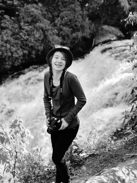 Aaron Blackwell Photography Photographer Waterfall One Person Plant Portrait Leisure Activity Clothing Standing Lifestyles Looking At Camera Nature Front View Day Smiling Women Tree Real People Young Adult Hat Outdoors The Portraitist - 2018 EyeEm Awards