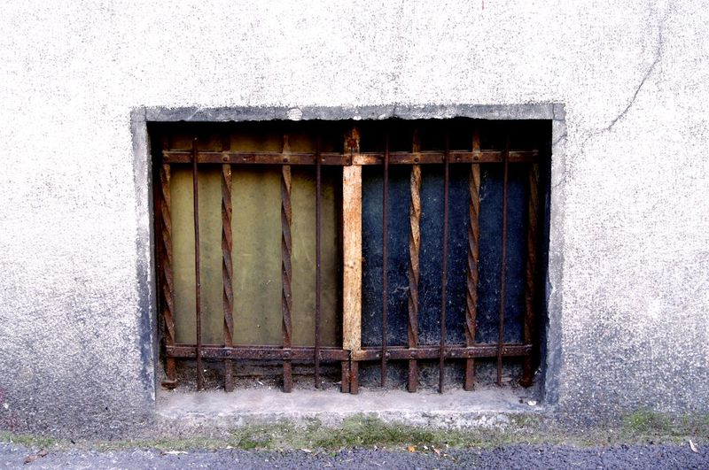 Window with metal bars Architecture Bars Blue Building Exterior Built Structure Close-up Closed Day Deterioration House Jail Locked No People Old Outdoors Prisoner Residential Structure Window Wood - Material Fine Art Photography