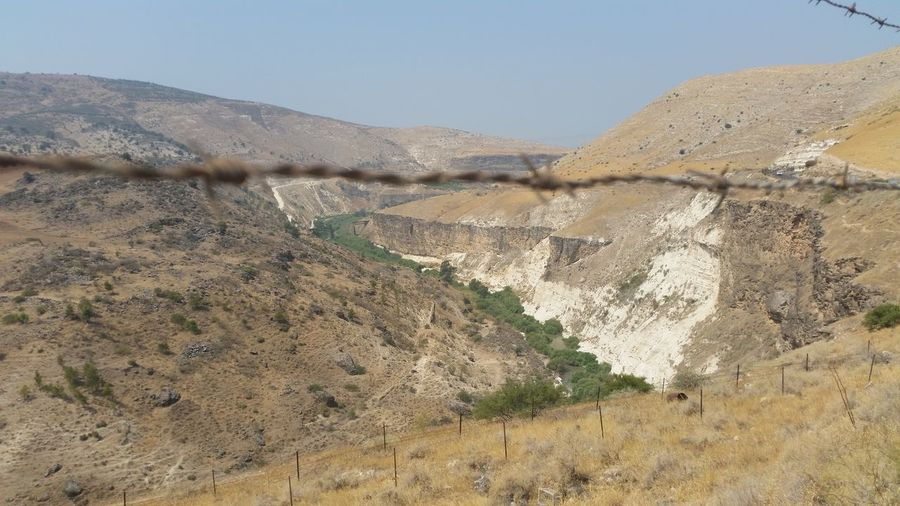 landscape of the Golan Heights Barbed Wire Beauty In Nature Danger Day Defence Defense Golan GolanHeights Landscape Military Mountain Mountain Range Nature Protection River Yarmouk Road Scenics Sky Tranquil Scene