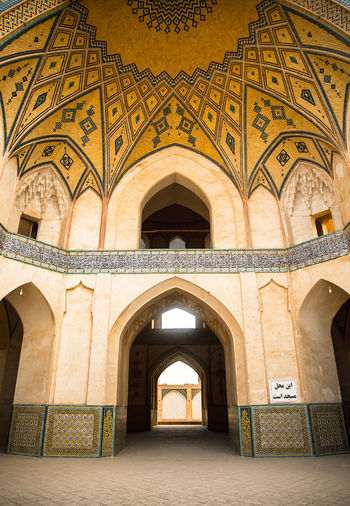 Agha Bozorg mosque (Persian: مسجد آقا بزرگ Masjed-e Āghā Bozorg) is a historical mosque in Kashan, Iran. The mosque was built in the late 18th century by master-mimar Ustad Haj Sa'ban-ali. The mosque and theological school (madrasah) is located in the center of the city.Agha Bozorgh Mosque was constructed for prayers, preaching and teaching sessions held by Molla Mahdi Naraghi II, known as Āghā Bozorgh. Agha Bozorg Mosque Arch Architectural Feature Architecture Archway Beautiful Built Structure Ceiling Church Column Fantastic Geometry Historic History Indoors  Kashan Old Ornate Place Of Worship Religion Symmetry مسجد آقا بزرگ