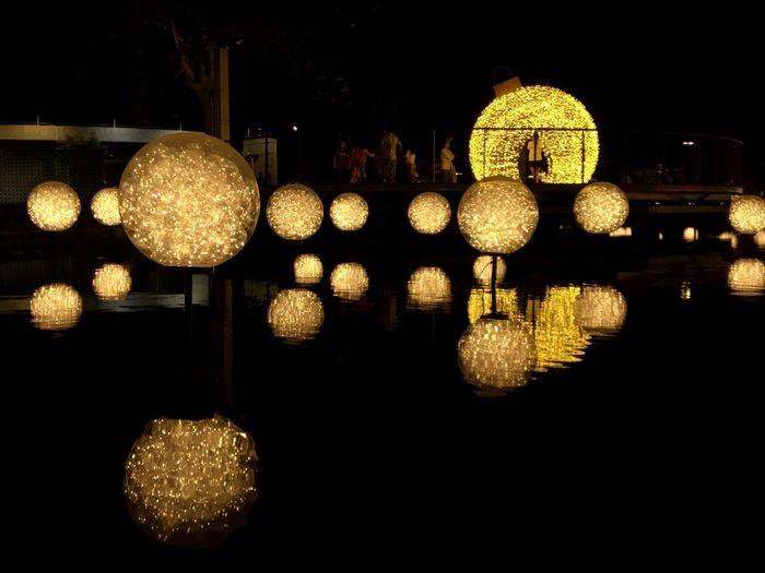 Illuminated lights in water at night