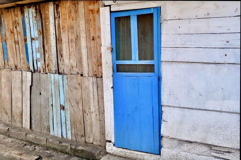 Closed blue door of old building