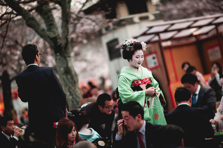 Focus On Foreground Geisha Japan Kyoto Large Group Of People Lifestyles Maiko Men Outdoors People Real People Traditional Clothing Tree Women