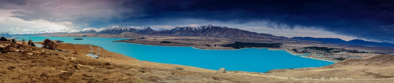 Panoramic view of mountains and lake against sky