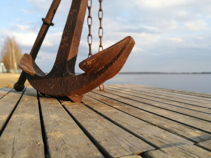 Close-up of rusty pier against sky