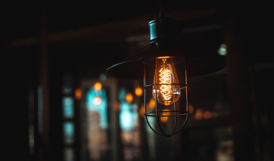 """Darkness cannot drive out darkness: only light can do that. Hate cannot drive out hate: only love can do that"" Martin Luther King Jr. Filament Illuminated Hanging Light Bulb Electricity  Lighting Equipment Close-up Lantern Electric Light Oil Lamp Building Darkroom Historic Exterior"