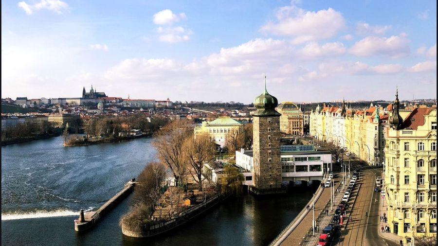 I shot this from atop the Dancing House building in Prague. Architecture Built Structure Building Exterior Transportation City Sky High Angle View Bridge - Man Made Structure Mode Of Transport River Day Cloud - Sky Outdoors Connection Cityscape Nautical Vessel Water City Life Travel Destinations No People The Photojournalist - 2017 EyeEm Awards