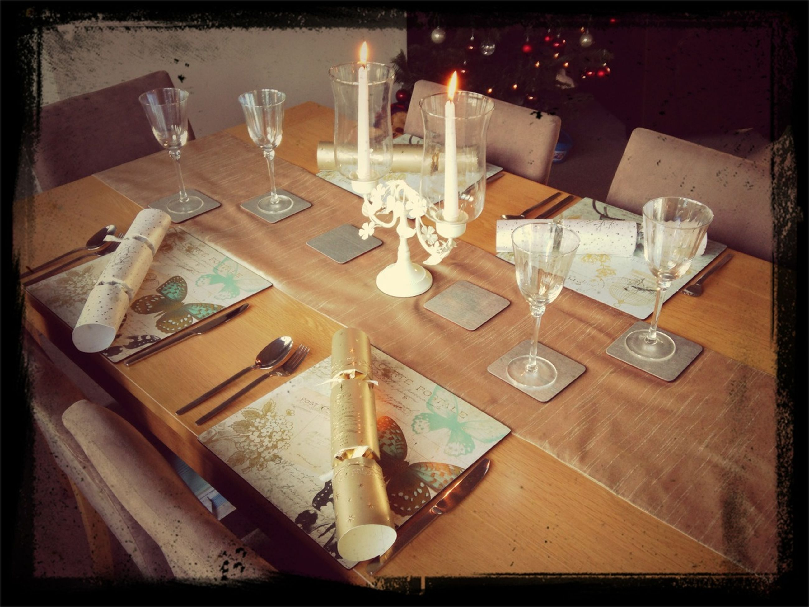 indoors, table, transfer print, still life, auto post production filter, high angle view, no people, glass - material, drinking glass, drink, food and drink, restaurant, absence, bottle, close-up, home interior, wineglass, fork, arrangement, place setting