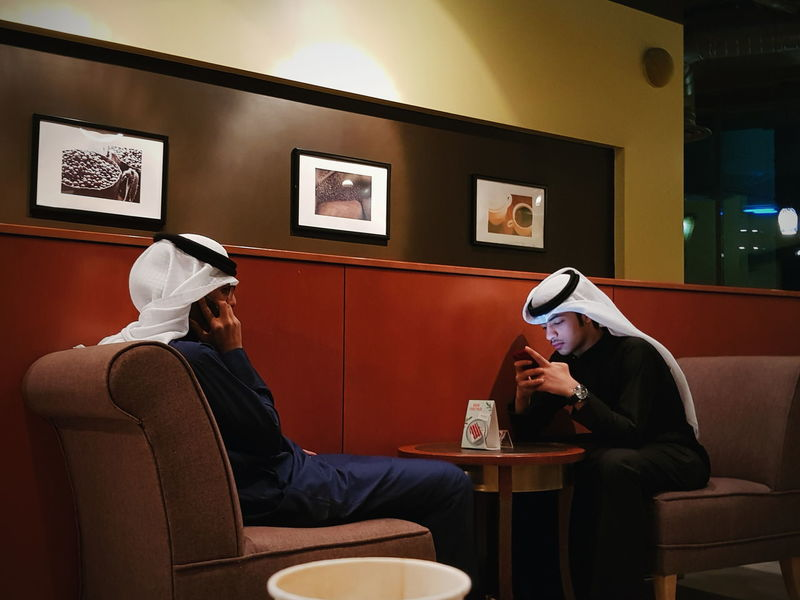 Kuwait Yoonjeongvin Two People Sitting Adults Only Happy Hour Drinking Adult Indoors  Drink Lifestyles Men Relaxation Friendship Leisure Activity Young Adult Arts Culture And Entertainment People Inner Power Stories From The City The Street Photographer - 2018 EyeEm Awards #urbanana: The Urban Playground