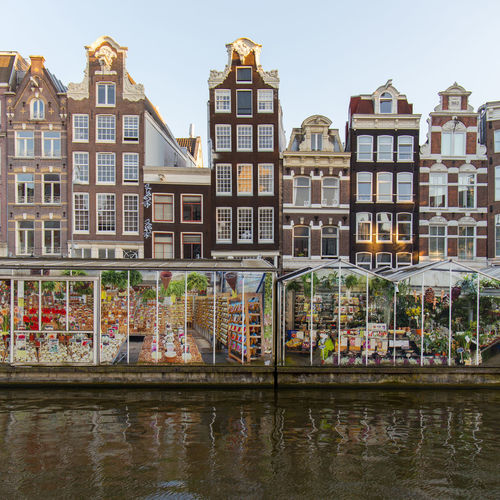 Amsterdam Floating Flower Market Netherlands Amsterdam Floating Flower Market Apartment Architecture Bloemenmarkt Building Building Exterior Built Structure Canal City Day Dutch Architecture Dutch Houses Holland House Nature No People Outdoors Reflection Residential District Row House Sky Water Waterfront Window