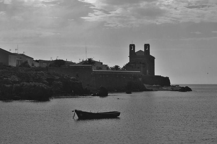 ArtWork Relaxing Tranquility Scene Art Beachphotography Sea Sky And Clouds Tied Boat Alicante, Spain Boat Tranquility Beach Place Of Interest Island Tabarca Nobody Boats Tabarca's Island Fishermen Island Life Alicante Islandlife Black And White Blackandwhite Fisherman