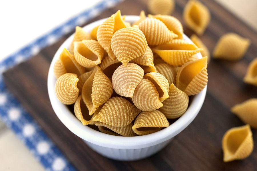 Conchiglie Pasta. Color Conchiglie Pasta Italian Pasta Natural Light Blue Napkin Bowl Carbohydrates Close Up Conchiglie Cutting Board Dry Pasta Food Food And Drink Italian Food No People Nutrition Pasta Still Life Studio Photography Wooden Background