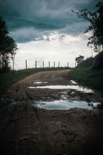 Going for a walk in Salento. No People Outdoors Land Nature Cloud - Sky Environment South America Latin America Landscape Moody Dark Mountain Exploration Adventure Explore Non-urban Scene Idyllic Remote Travel Destinations Ominous Overcast Rural Scene Puddle The Way Forward Road