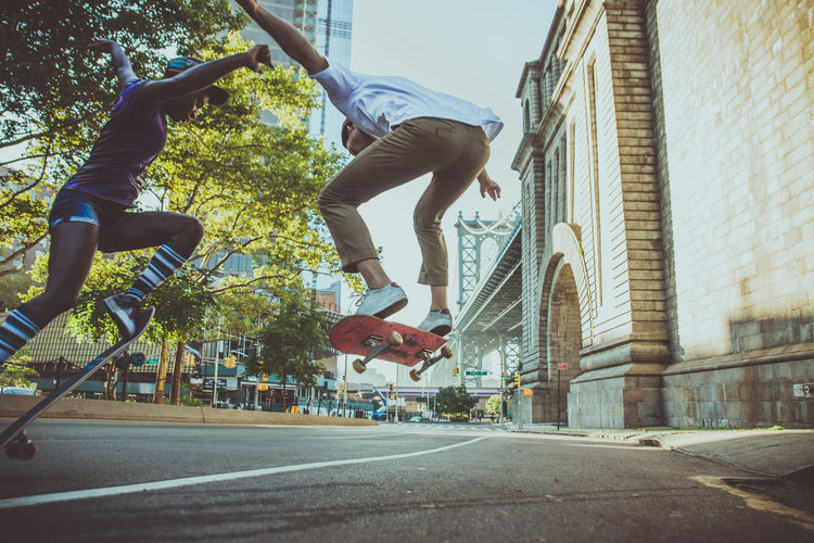 Man jumping in front of building
