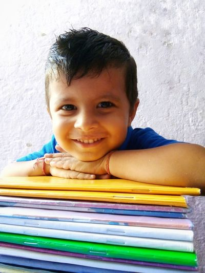 portrait of confident, smiling little boy with books Cute Smile  Cuteness Attractive Cheerful Happiness Education Toothy Smile Smiling Confidence  Looking At Camera Kid Indian Culture  Window Light Portrait Indian Child Childhood Facial Expression Portrait Education Occupation School Supplies Workbook Homework Textbook Studying Back To School Elementary School Elementary Student Schoolboy School Children The Portraitist - 2018 EyeEm Awards A New Perspective On Life