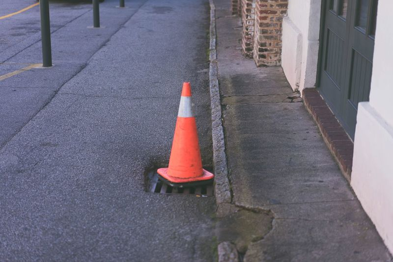 Traffic cone on sewer at road