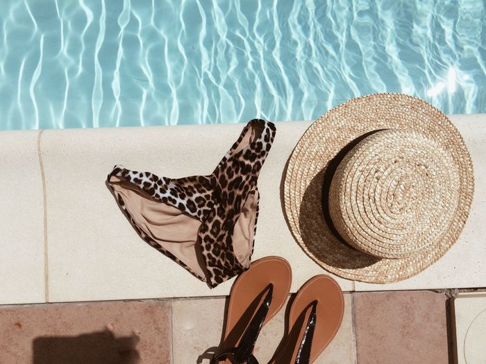 Pool Water Swimming Pool Hat Sunlight Nature Day No People Shadow Clothing Relaxation Summer Pattern Straw Hat Poolside Striped High Angle View Sun Hat Vacations Outdoors