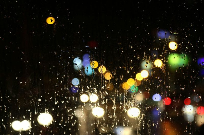 The colors of lights in raining night on the road .go home on Night Lights Night In The Car From My Window In Front Corlorful Raindrops Rainy Night Popular