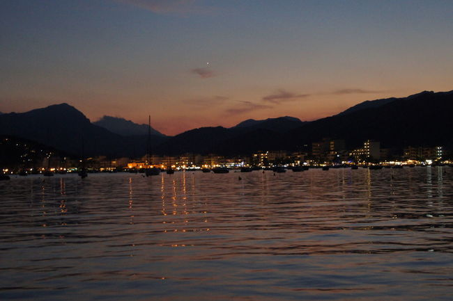 scenic view of sea against sky at night Harbor Holiday Mallorca Beauty In Nature Mountain Mountain Range Nature Nautical Vessel Night No People Outdoors Pollença Scenics Sea Ship Silhouette Sky Sundown Sunset Tranquility Water Waterfront