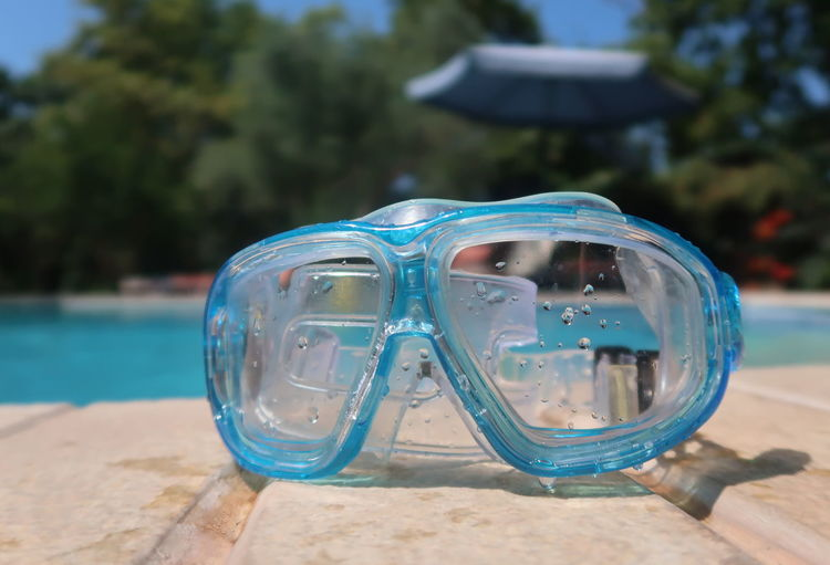 Snorkel mask by the pool Goggles Recreation  Snorkeling Swimming Travel Blue Close-up Concept Eyewear Hotel Leisure Lifestyles Mask No People Outdoors Personal Accessory Pool Protection Resort Snorkel Summer Sunlight Swimming Pool Vacation Water