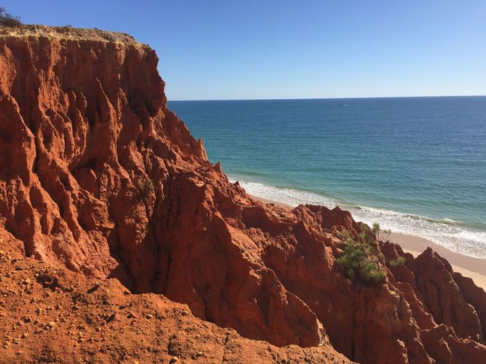 Sea Nature Rock Formation Beauty In Nature Tranquil Scene Scenics Rock - Object Clear Sky Tranquility Horizon Over Water Water Outdoors Beach Sunlight Day No People Sand Cliff Blue Sky No Edit/no Filter No Filter Algarve Nature Blue Sky The Traveler - 2018 EyeEm Awards
