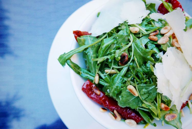 High angle view of arugula salad on plate