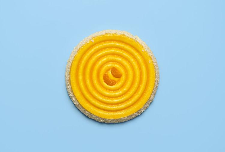 Close-up of lemon slice against blue background