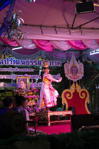 Sam Phran,Nakhon Pathom,Thailand-April 07,2015 ;.The one women show on stage - performance space at night The Festival Wat Rai Khing Celebration Day Hanging Illuminated Indoors  No People Performance Performance Art Performance Group Performance Show