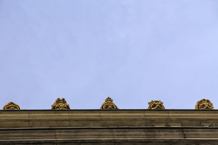 Low angle view of carving on roof against sky