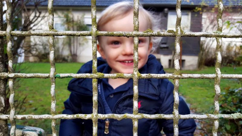 Boy Laughing Fence Outside Childsplay Colourful Lovingly My Love In My Garden In Front Of Me Selective Focus EyeEm EyeEm Gallery Portrait Colour Portrait Fashion Streetphotography Faces In Places