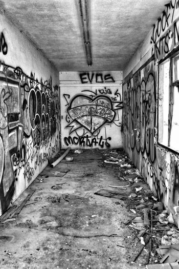 Graffiti on wall of abandoned building