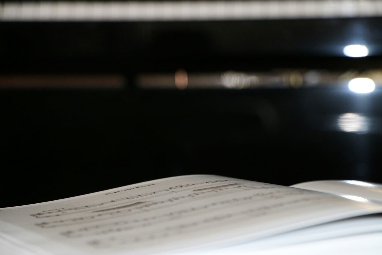Close-Up Of Music Notebook On Table