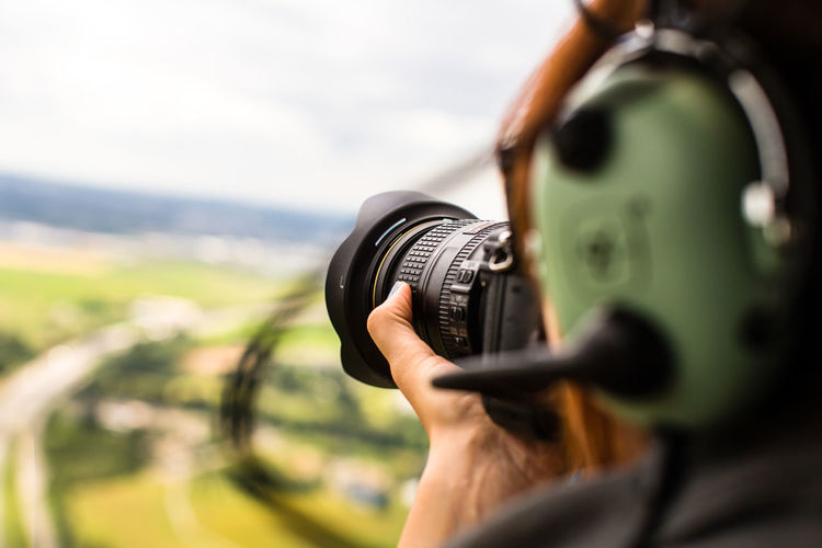 Cropped Image Of Person Photographing Through Camera
