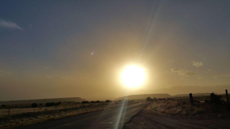 Large Sun Setting Sunset #sun #clouds #skylovers #sky #nature #beautifulinnature #naturalbeauty #photography #landscape Haze From Fire Smoke Filled Sky Mountains Paved Roadway