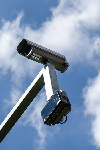surveillance camera Crime Security Blue Cloud - Sky Day Low Angle View No People Outdoors Safety Sky Sunlight Surveillance Surveillance Camera Terrorism