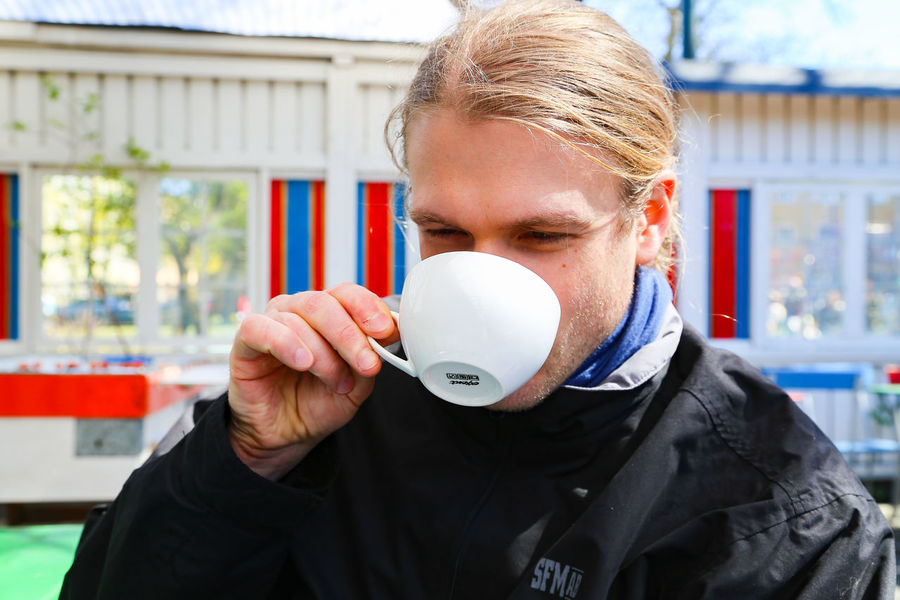 Caffeine Coffee Drinking Coffee Drinking Cappuccino Porcelain  Architecture Blond Hair Cafe Close-up Coffee Cup Day Focus On Foreground Front View Full Frame Holding Holding Up One Person Outdoors Outdoors Photograpghy  Pleasure Real People Spring Springtime White Cup Young Adult