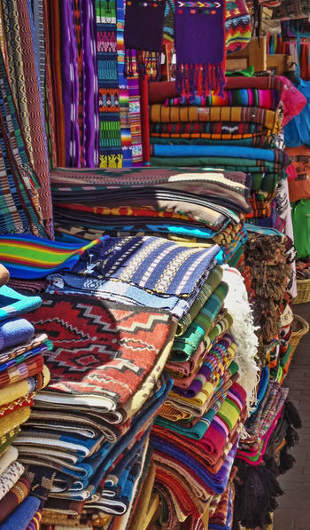 Sante Fe wares. Color and lines. We enjoyed visiting all the shops, and this photo captures the rich and vivid culture. Sante Fe New Mexico Shopping Store Tourism Tourist Sight Seeing Traveling Travel Mexico Pueblo Shop Keeper Blankets Beautiful Colorful Rich Colors Popular Culture Shopping ♡ Vendor Street Market Fabric Fashion Texture Lines Live For The Story The Street Photographer - 2017 EyeEm Awards