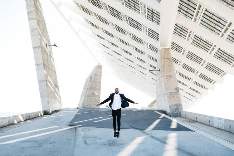 Man walking on modern building in city