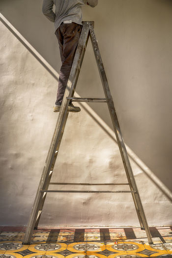 Men At Work  Abstract Architecture Day Light And Shadow Low Angle View Low Section Manual Worker Men One Person Outdoors Paint Roller Real People Wall - Building Feature Working