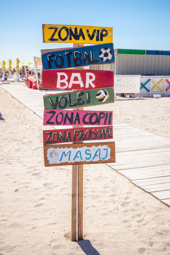 Beach signs pointing to fun and sports area at the Black Sea, Romania 2017. Fun Fun Zone Indicator Romania Sign Beach Black Sea Close-up Communication Day Miscellaneous  Nature No People Outdoors Resort Sand Sea Sky Text Vacations Be. Ready.