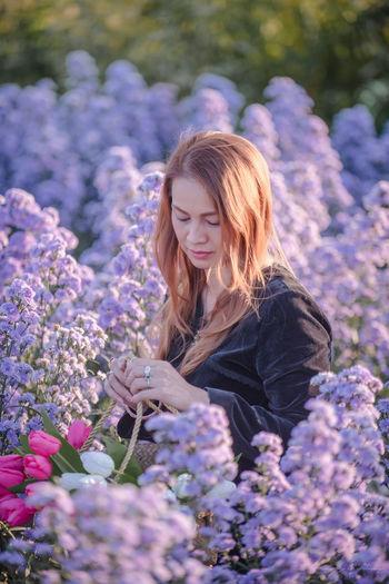 Beautiful woman in flowering plants