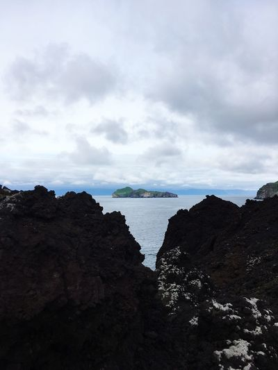 Island Beauty In Nature One Lava Oceanside Ocean View Ocean Island Water Sea Cloud - Sky Beach Sky Land Scenics - Nature Tranquility Beauty In Nature Tranquil Scene Rock Nature Non-urban Scene Day Rock - Object Travel Destinations Solid No People Outdoors