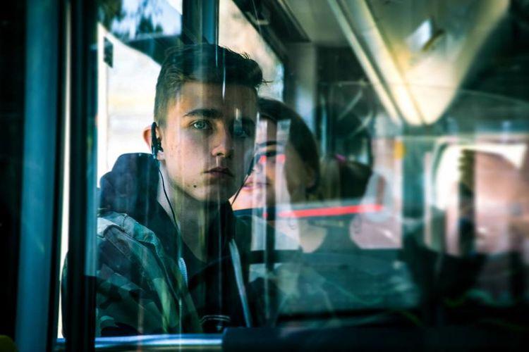 Poland Photography Photooftheday EyeEm Bus Boy Thinking EyeEmNewHere Window Looking Through Window Public Transportation Mode Of Transport Transportation Passenger Reflection Travel Waiting Commuter Journey