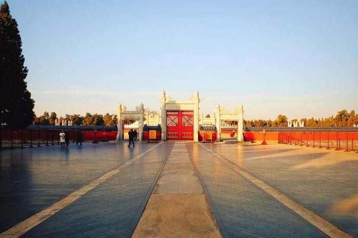 Outdoors Day Sky City Cityscape Street Photography Beijing, China Architecture Built Structure Sunlight Temple Of Heaven Park Old Architecture Traditional Architecture Cityscape Blue Shadows & Lights Travel Destinations City Life Warm Winter Scenics Travel FUJIFILM X-T10 Leisure Time Light And Shadow Freshness