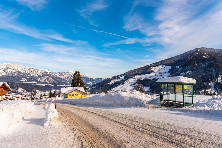 Scenic view of snowcapped mountains against sky ski bus stop ski region schladming dachstein austria
