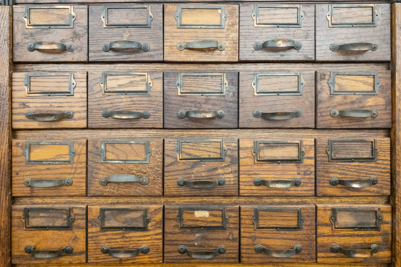 Perfectly organized Cabinet Vintage Old Wood Organization Organized In A Row Backgrounds Full Frame Indoors  Wood - Material No People Repetition Order Brown Book Architecture Antique Close-up Drawer Studio Shot Pattern History