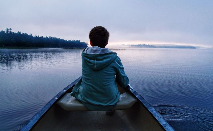 Rear View Water One Person Lake Real People Leisure Activity Nature Outdoors Beauty In Nature Scenics Looking At View Tranquility Sitting Women Day Lifestyles Sky Only Women People One Woman Only Canoe Lake Fresh on Market 2017 Perspectives On Nature